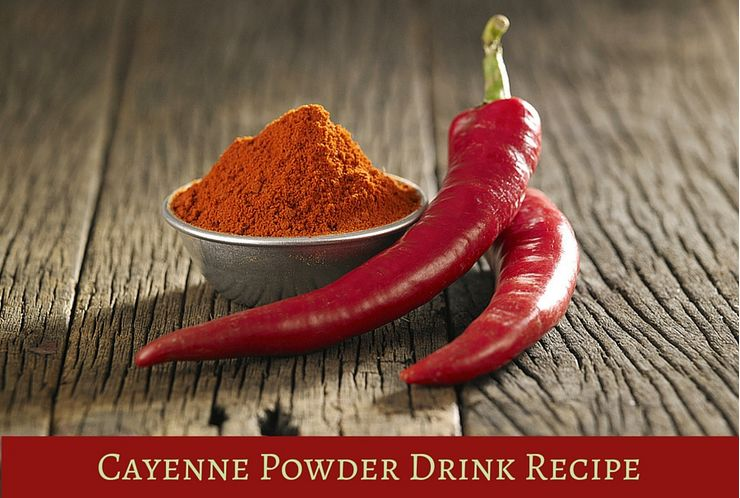 Cayenne Peppers and Powder on Wooden Table